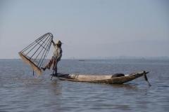 Fischer mit Reuse